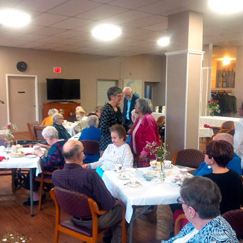People socializing at the Foundation's Appreciation Tea 2018
