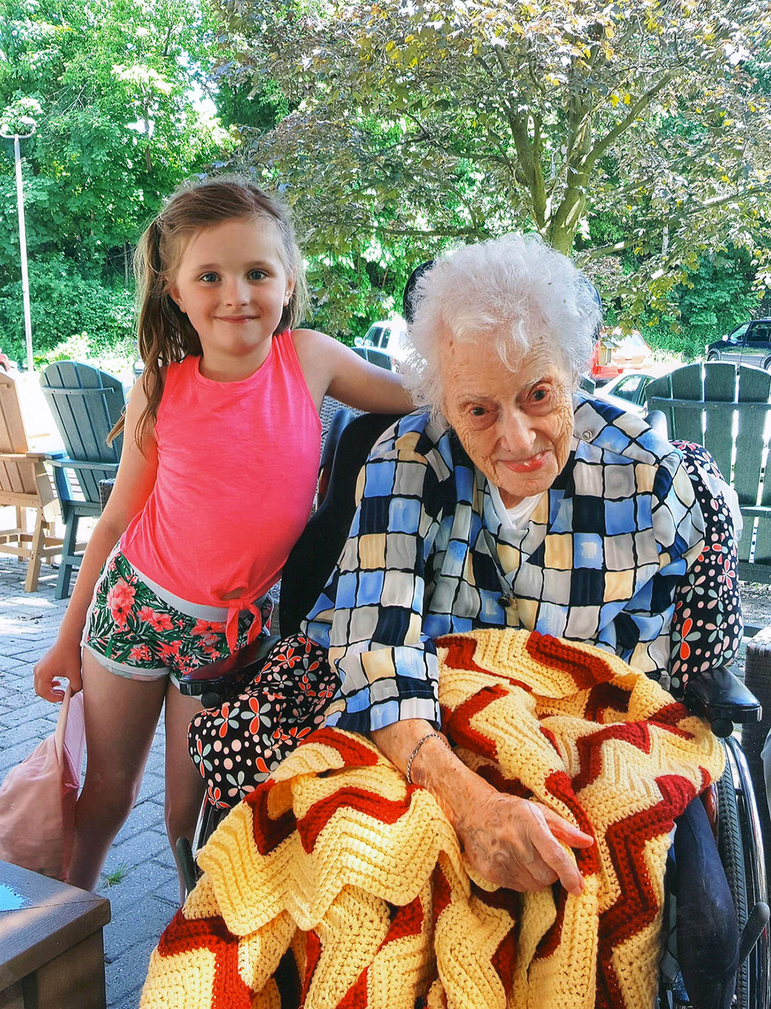 Resident in wheelchair with her grandchild