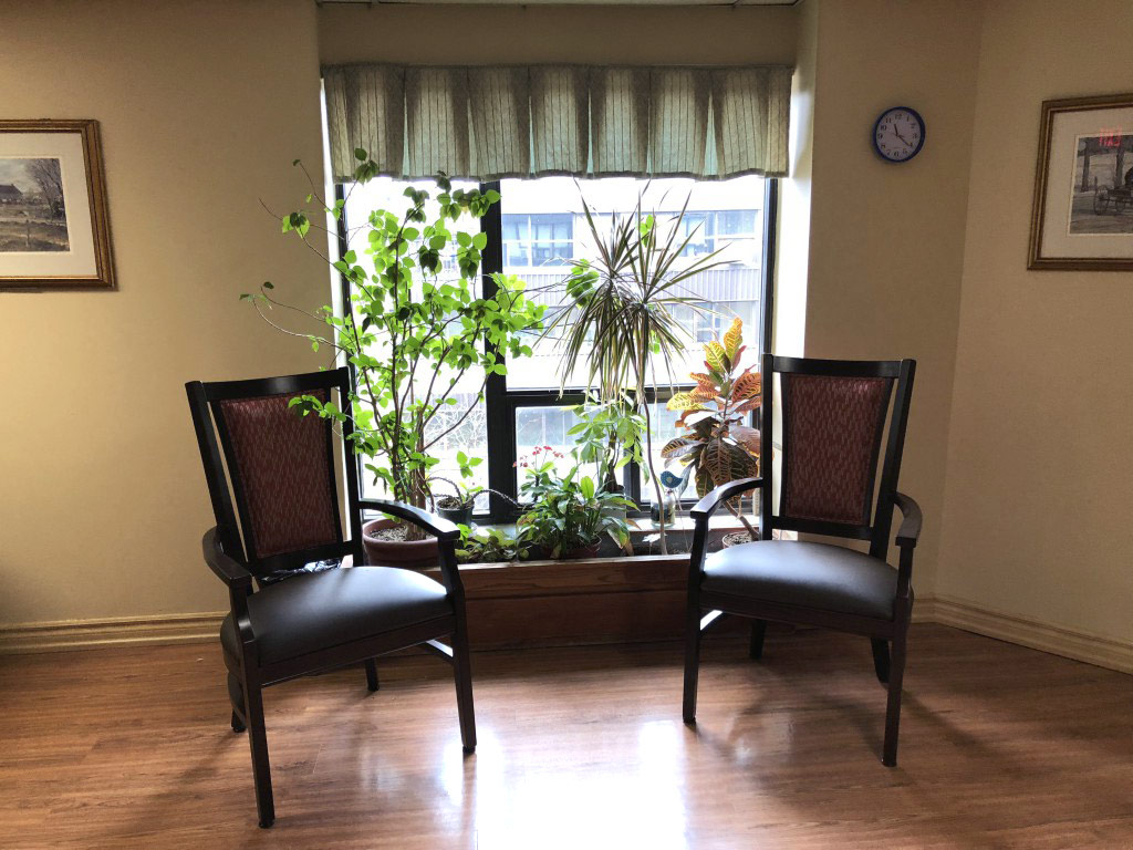 two chairs beside a window in an apartment at SCOC