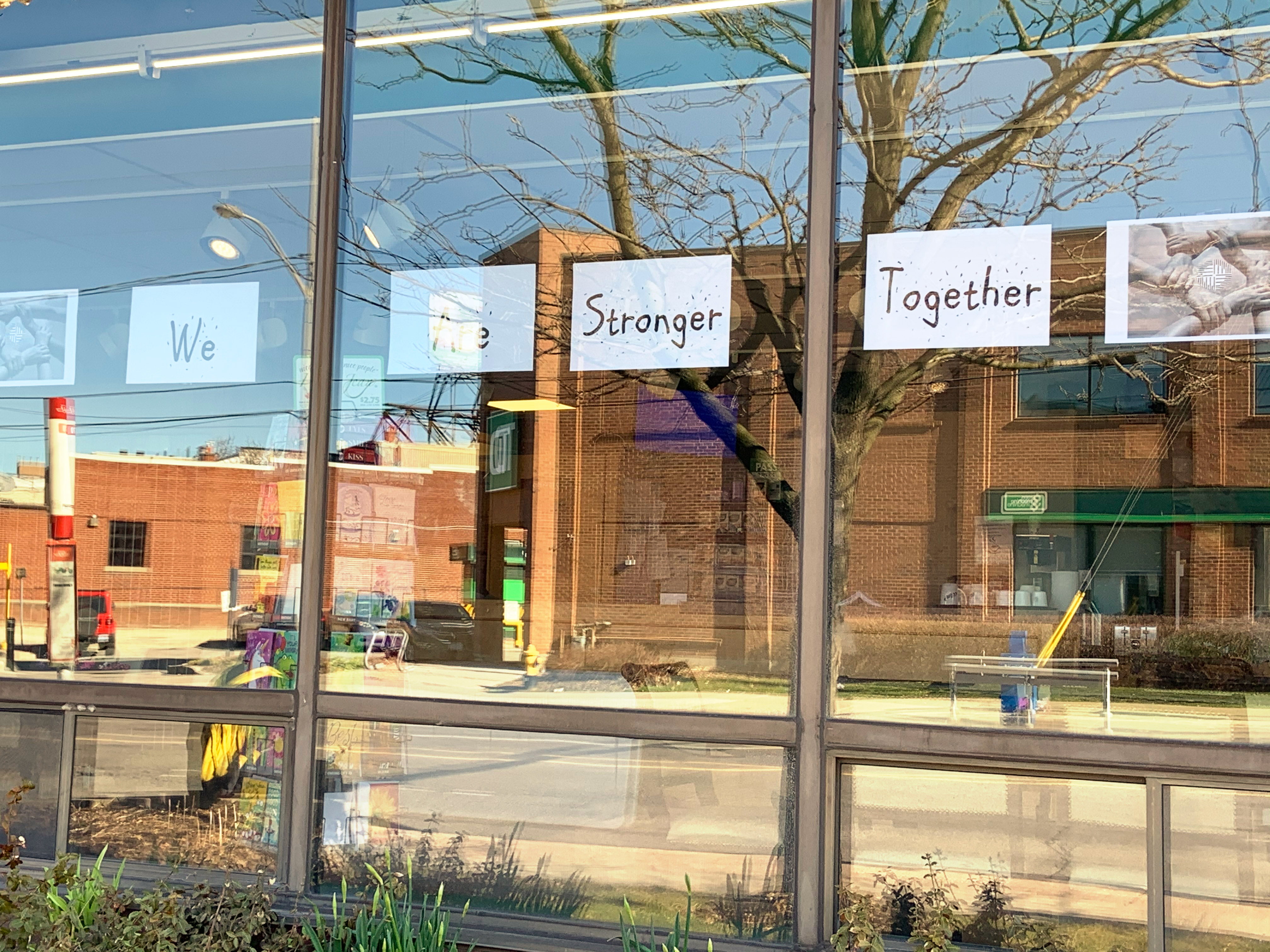 Message on window of SCOC: We are Stronger Together